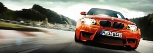 orange bmw driving