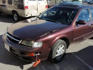 front car bumper dent