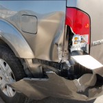 SUV bumper dent damage