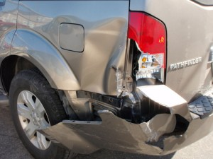 SUV bumper dent damage