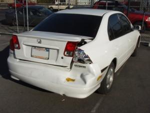 white civic dented bumper repair