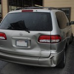 Silver van with dented rear