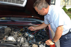 Mechanic checking car engine